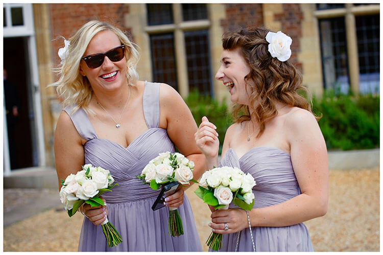 Madingley Hall Wedding bridesmaids laughing