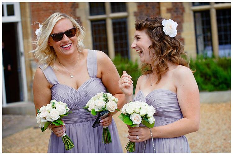 Madingley Hall Wedding bridesmaids laughing
