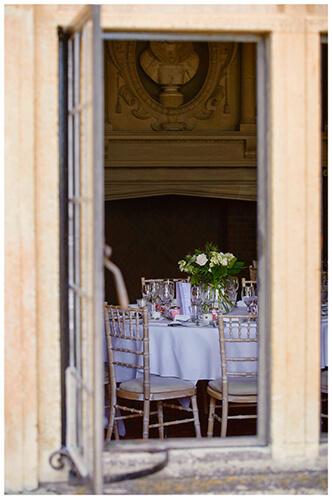 Madingley Hall Wedding venue dinging room through window