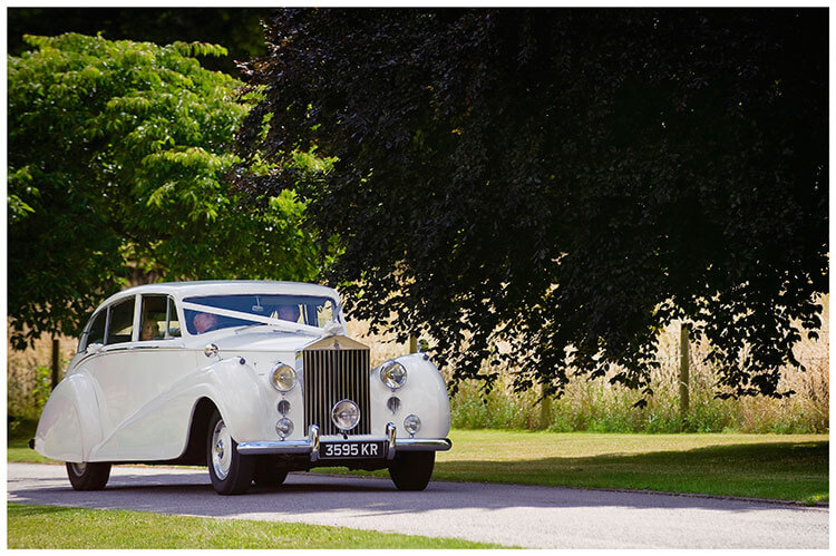 Madingley Hall Wedding car bring bride