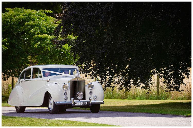Madingley Hall Wedding car bring bride