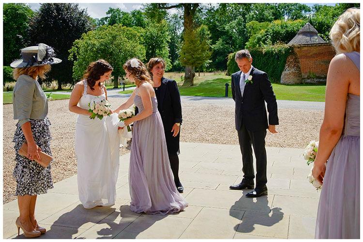 Madingley Hall Wedding last adjustments for the bride