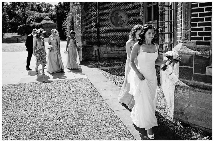 Madingley Hall Wedding bride followed by parents and bridesmaids