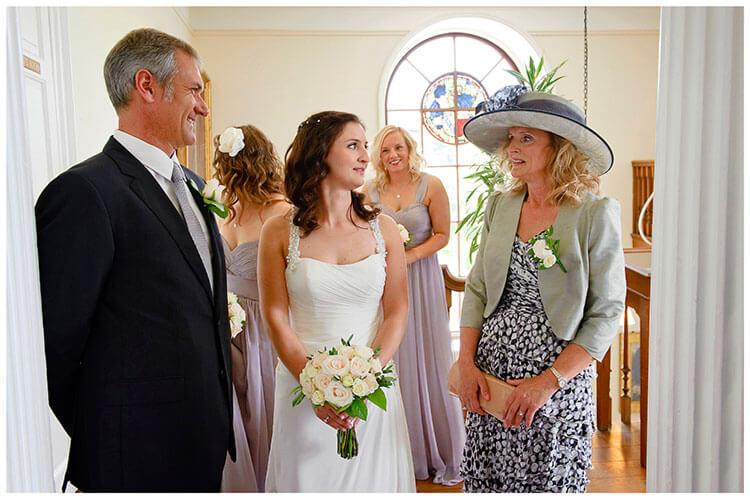 Madingley Hall Wedding bride waits to enter