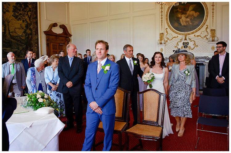 Madingley Hall Wedding bride arrives next to the groom