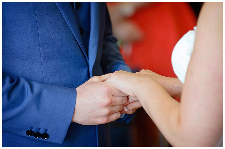 Madingley Hall Wedding holding hands