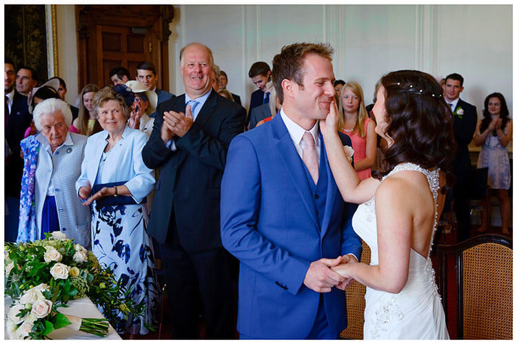 Madingley Hall Wedding bride caresses grooms face