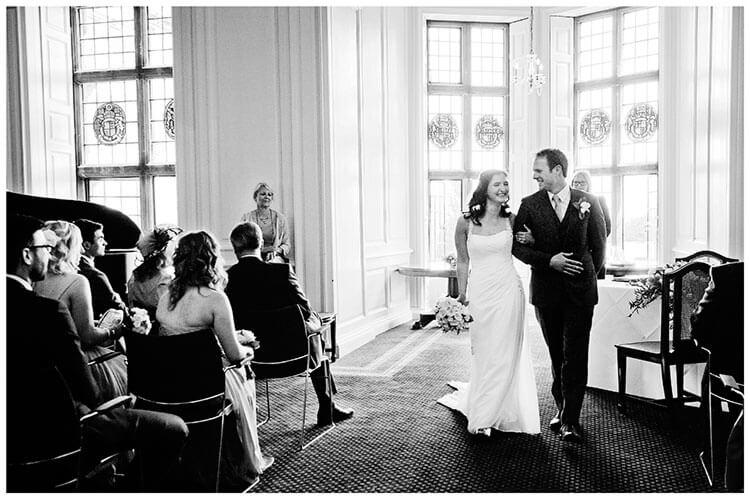 Madingley Hall Wedding bride groom leaving after ceremony