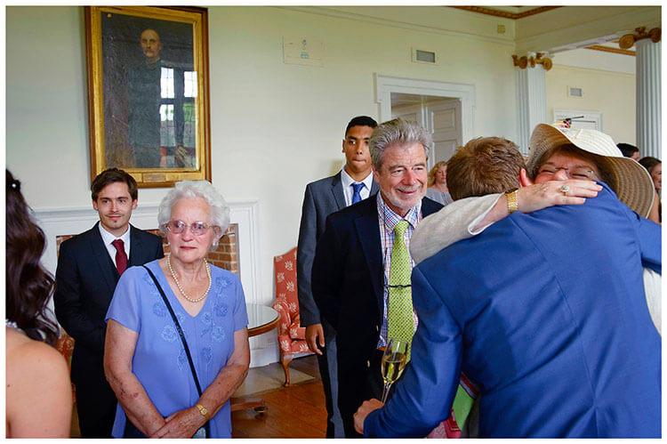 Madingley Hall Wedding big hug for the groom