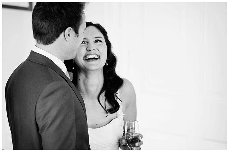 Madingley Hall Wedding laughing bride with groom