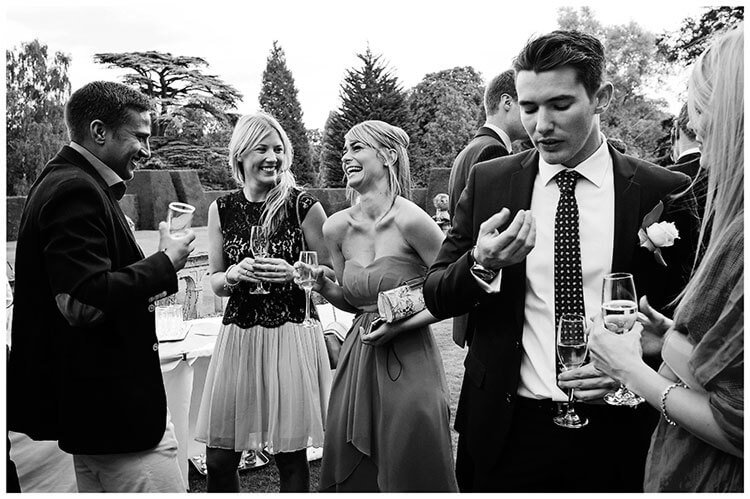 Madingley Hall Wedding laughing guests