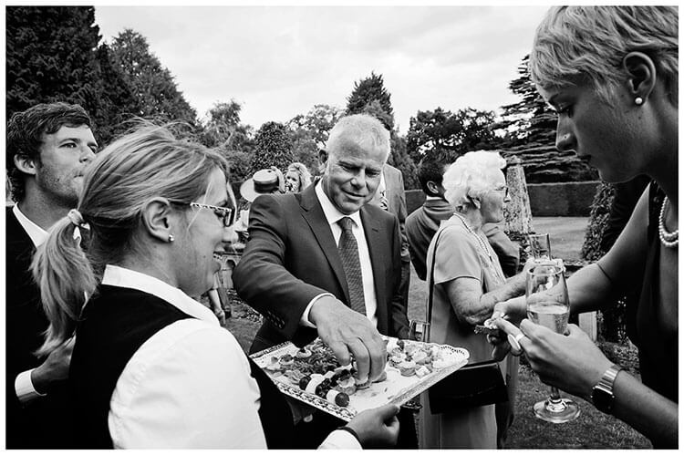 Madingley Hall Wedding guests select snacks