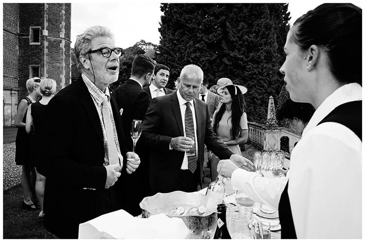 Madingley Hall Wedding guest ordering drink
