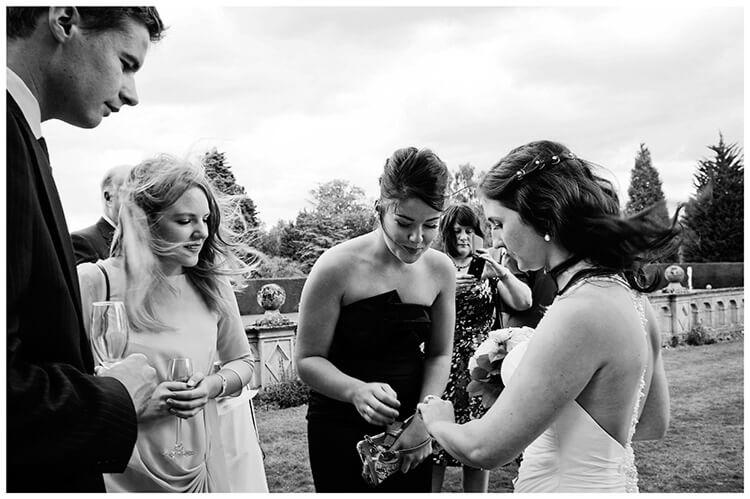 Madingley Hall Wedding bride shows off wedding band