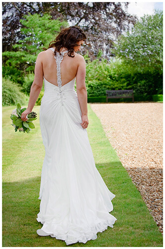 Madingley Hall Wedding bride walking away showing back of dress