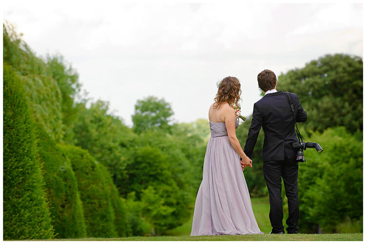 Madingley Hall Wedding couple holding hands