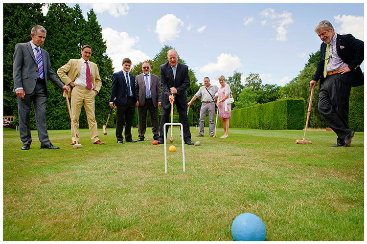Madingley Hall Wedding guests playing croquet