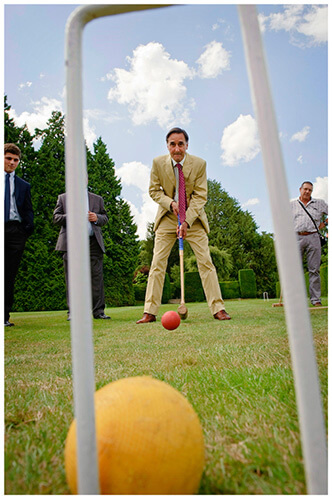 Madingley Hall Wedding through croquet hoop