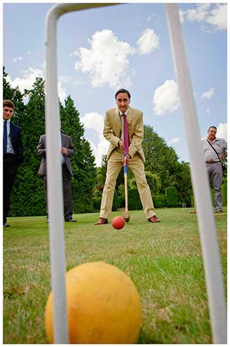Madingley Hall Wedding through croquet hoop