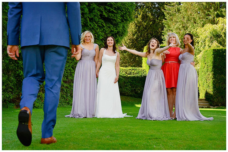 Madingley Hall Wedding bridesmaids bride welcome groom to their group