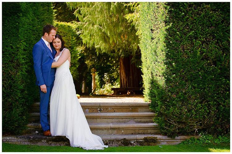 Madingley Hall Wedding bride groom hug