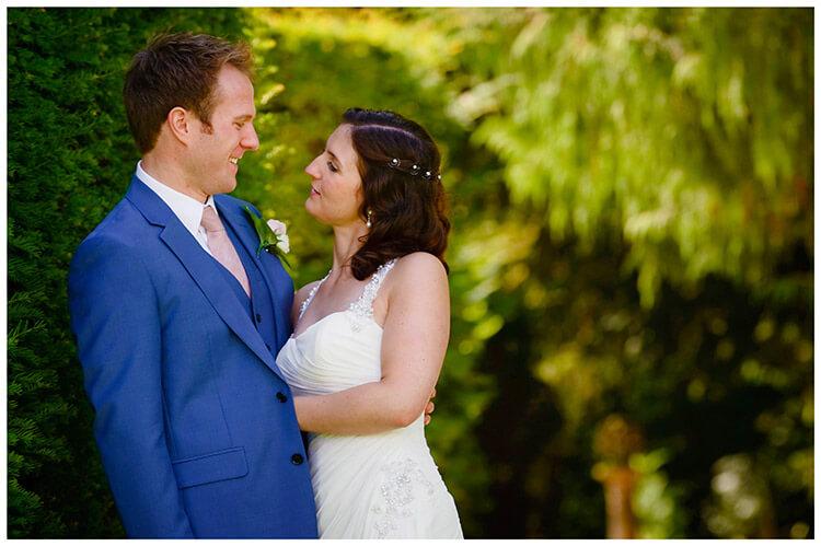 Madingley Hall Wedding bride groom embrace