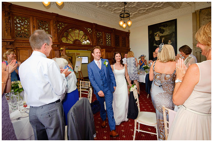 Madingley Hall Wedding bride groom enter dining hall