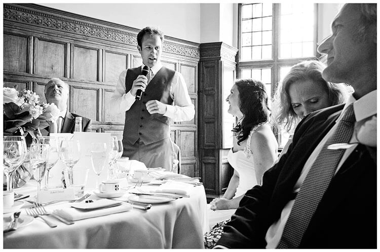Madingley Hall Wedding bride looking at groom during his speech