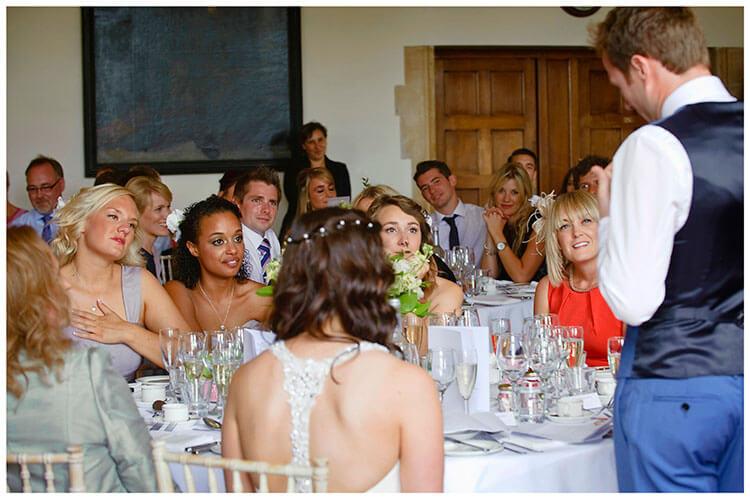 Madingley Hall Wedding bridesmaids listening to grooms speech