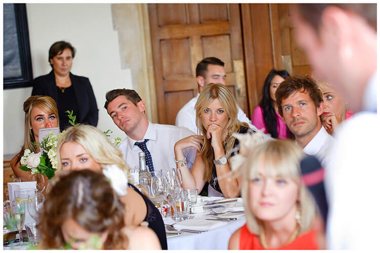 Madingley Hall Wedding grooms speech guests watching