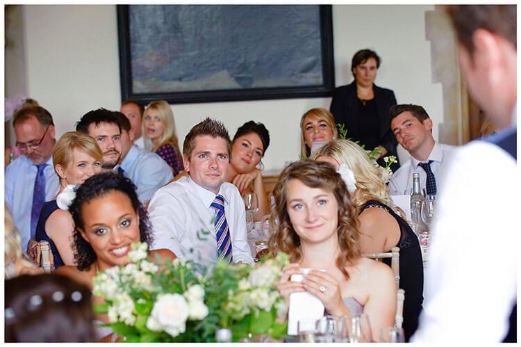 Madingley Hall Wedding guests listening to grooms speech