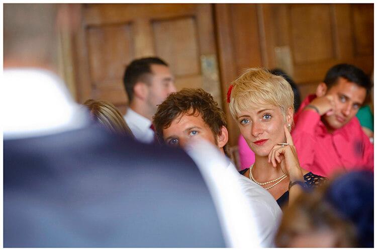 Madingley Hall Wedding guest intently listening to speech