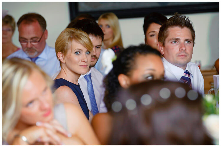 Madingley Hall Wedding guests listening to speeches