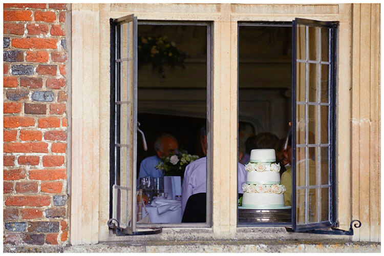 Madingley Hall Wedding cake through window