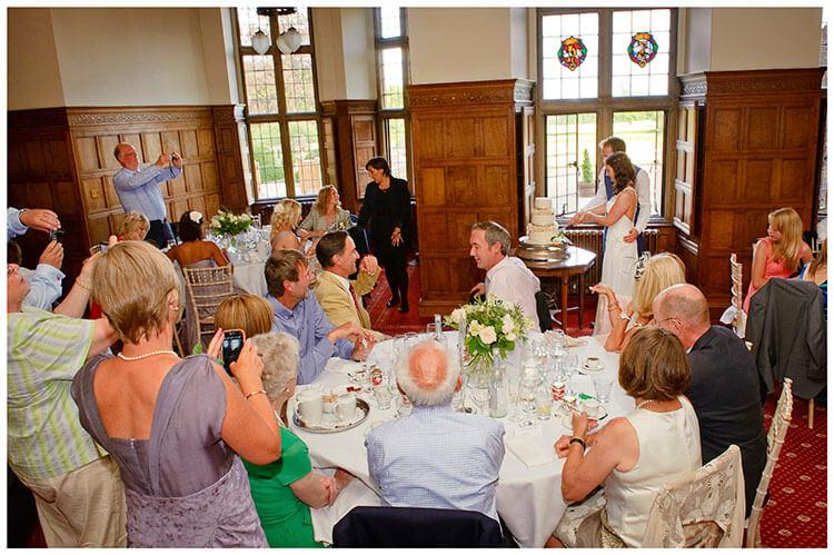 Madingley Hall Wedding cutting the cake