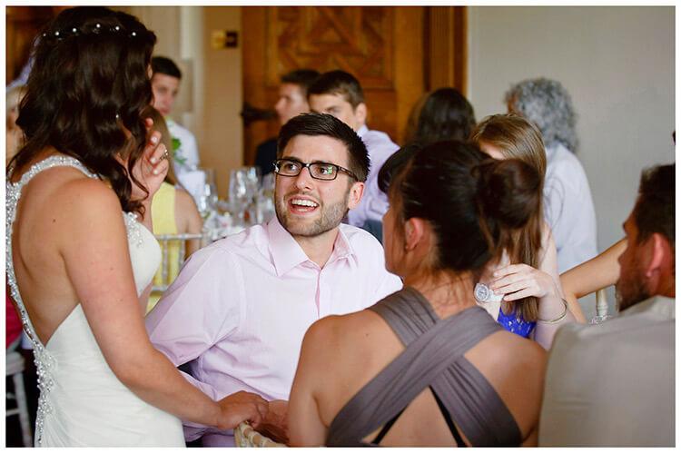 Madingley Hall Wedding bride talking to guests