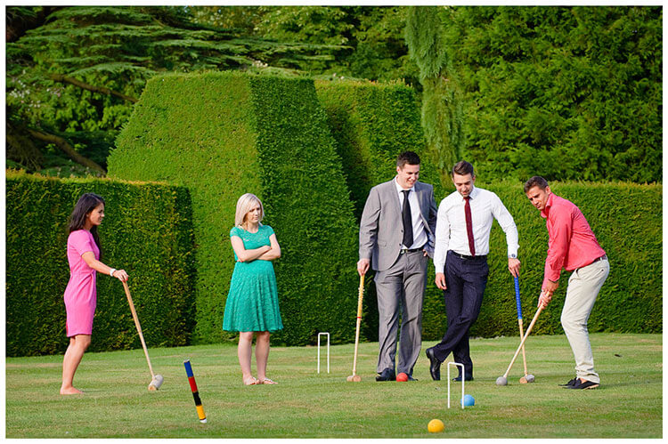Madingley Hall Wedding guests enjoying a game of croquet