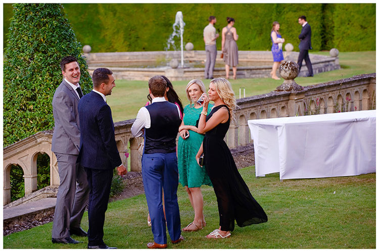 Madingley Hall Wedding guests in gardens