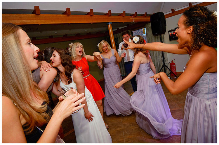 Madingley Hall Wedding bride bridesmaids on the dance floor