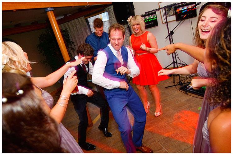 Madingley Hall Wedding groom strutting his stuff on the dance floor