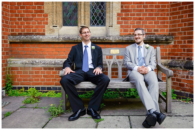 Groom bestman sat on bench