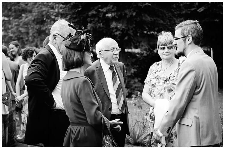 Michaelhouse wedding groom talking to guests