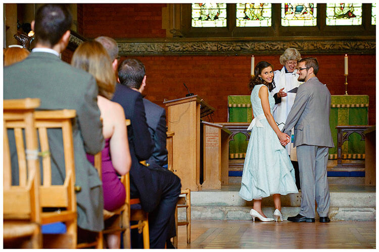 Michaelhouse wedding bride looks back at guests during ceremony