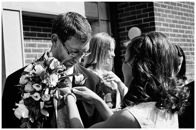 Michaelhouse wedding bride adjusting best mans tie