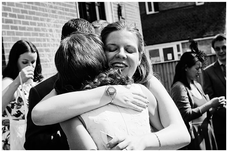 Michaelhouse wedding big hug for bride