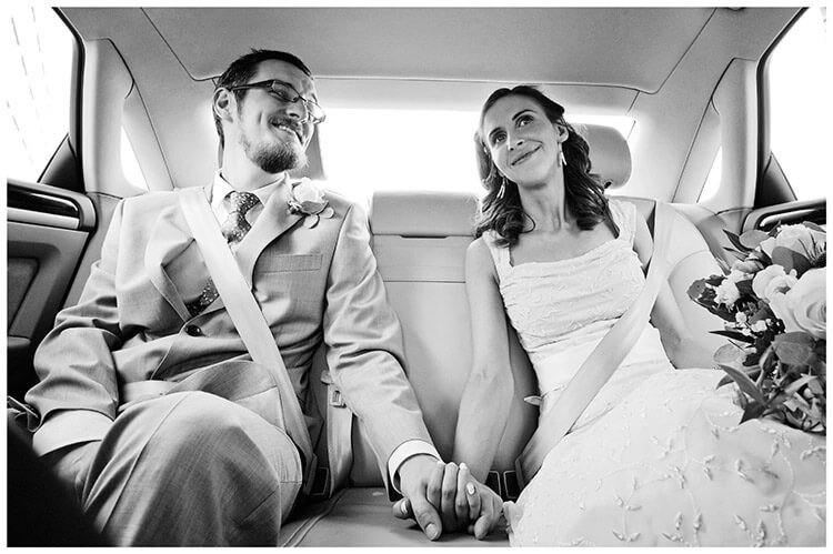 Michaelhouse wedding bride groom in car holding hands