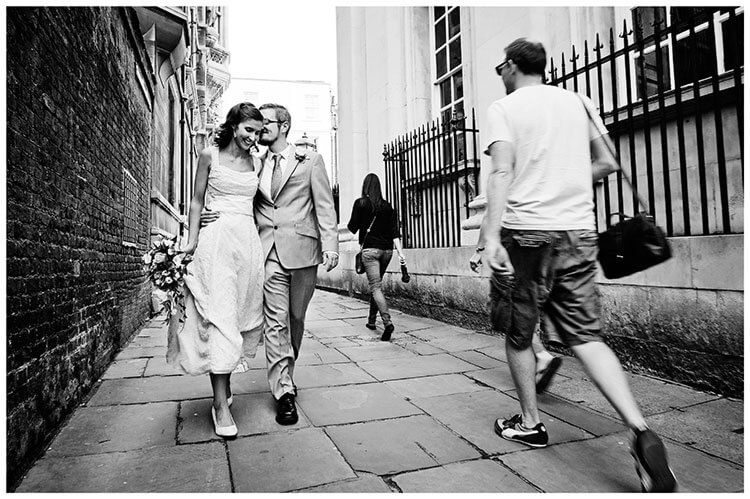 Michaelhouse wedding bride groom share moment on streets of Cambridge