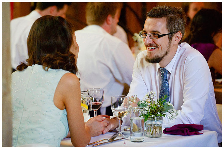 Michaelhouse wedding bride groom looking lovingly holding hands at dinner table