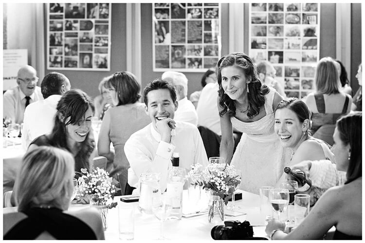 Michaelhouse wedding laughing guests sat at table