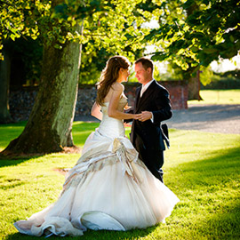 bride groom romantic moment in sunlight spains hall wedding